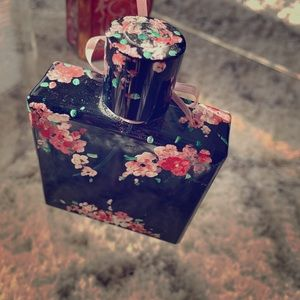 Hand painted square floral bottle.